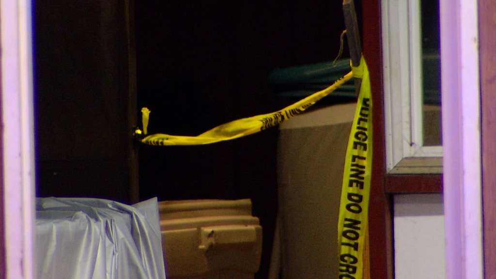 Picture of caution tape at the home where the shooting happend