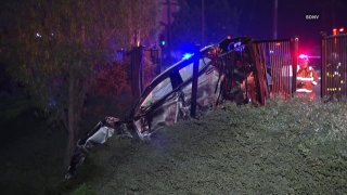 Car crashed through fence