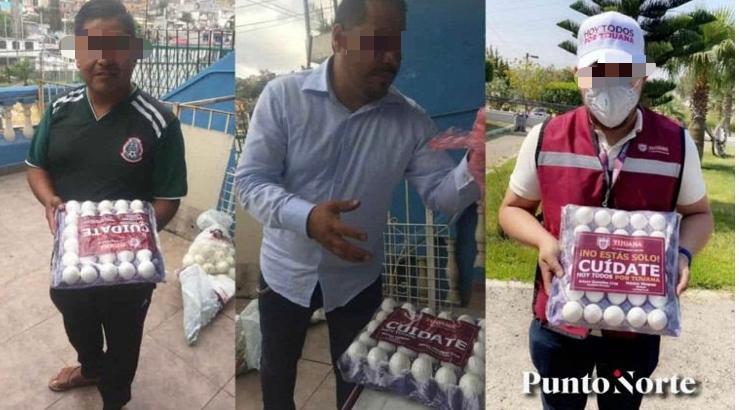 personas posan con huevos con el nombre del alcalde