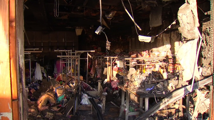 IT shows how the fire completely destroyed a clothing business