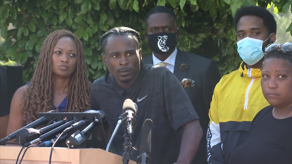 Johnson and other activists at a press conference in La Mesa