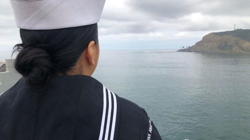 Sailor looks at San Diego coastline