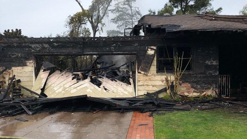 A burned home in El Cajon.