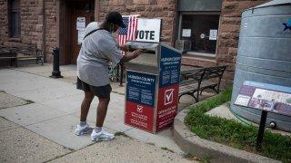 Voter drops off ballot