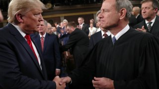U.S. President Donald Trump shakes hands with Supreme Court Chief Justice John Roberts before the State of the Union address in the House chamber on February 4, 2020 in Washington, DC.