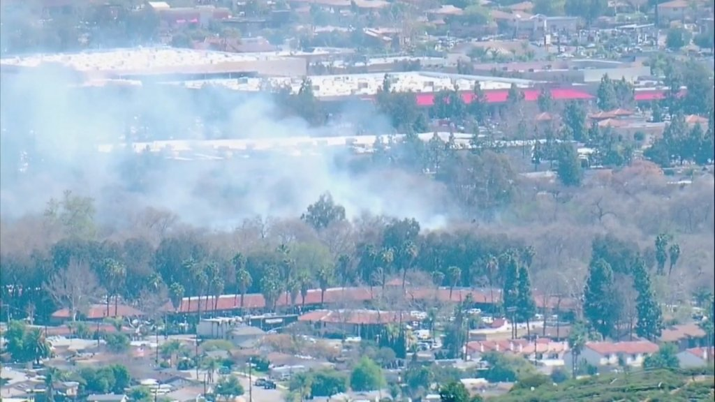 Smoke can be seen from a brush fire in Santee on Friday, Feb. 26, 2021.