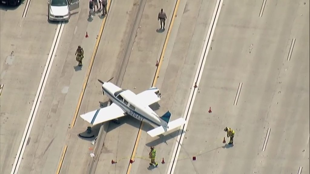 Aerial image shows first responders at the scene of the plane landing.
