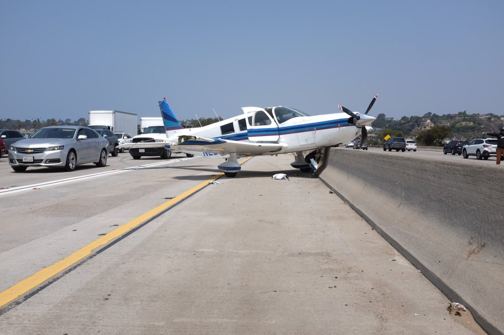 An airplane made an emergency landing on Interstate 5 near Del Mar on Tuesday, Aug. 24, 2021.